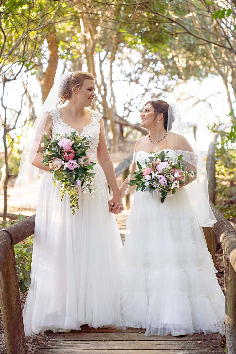 Wedding Photography - Brides holding hands