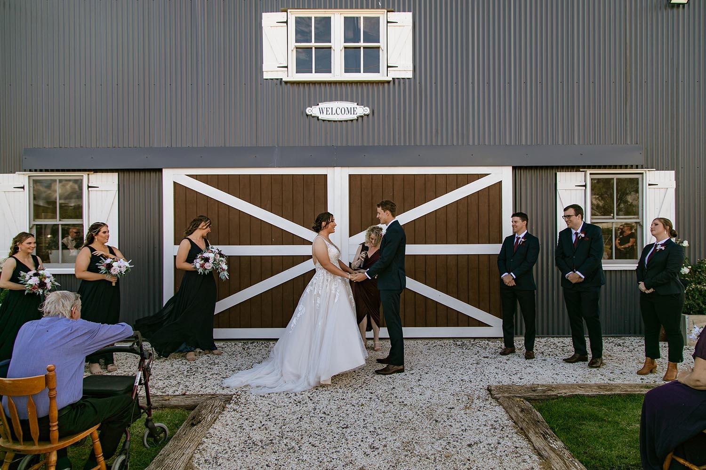 Wedding Photography - Bridesmaids holding groom