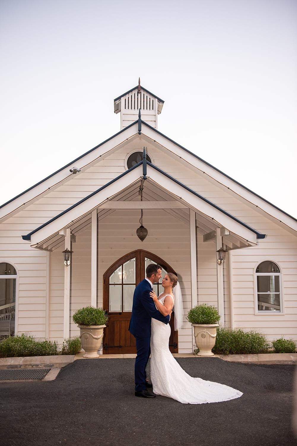 Wedding Photography - Couple in front of church