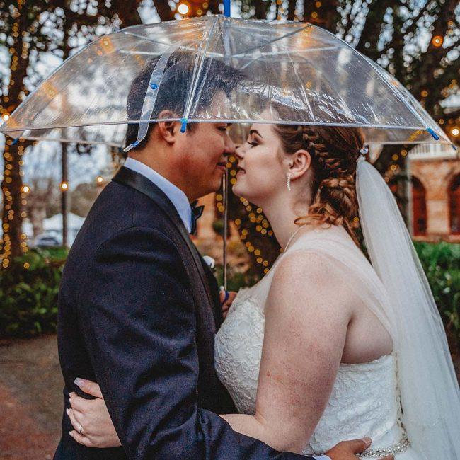 Wedding Photography - Couple under umbrella