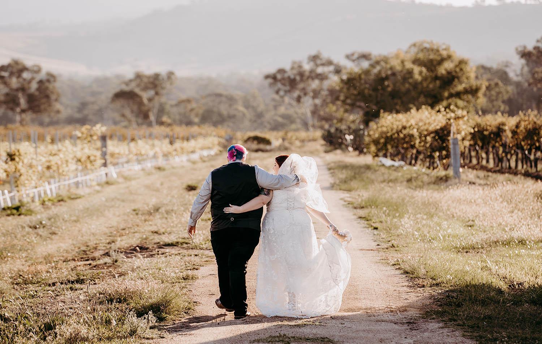 Wedding Photography - Couple walking away