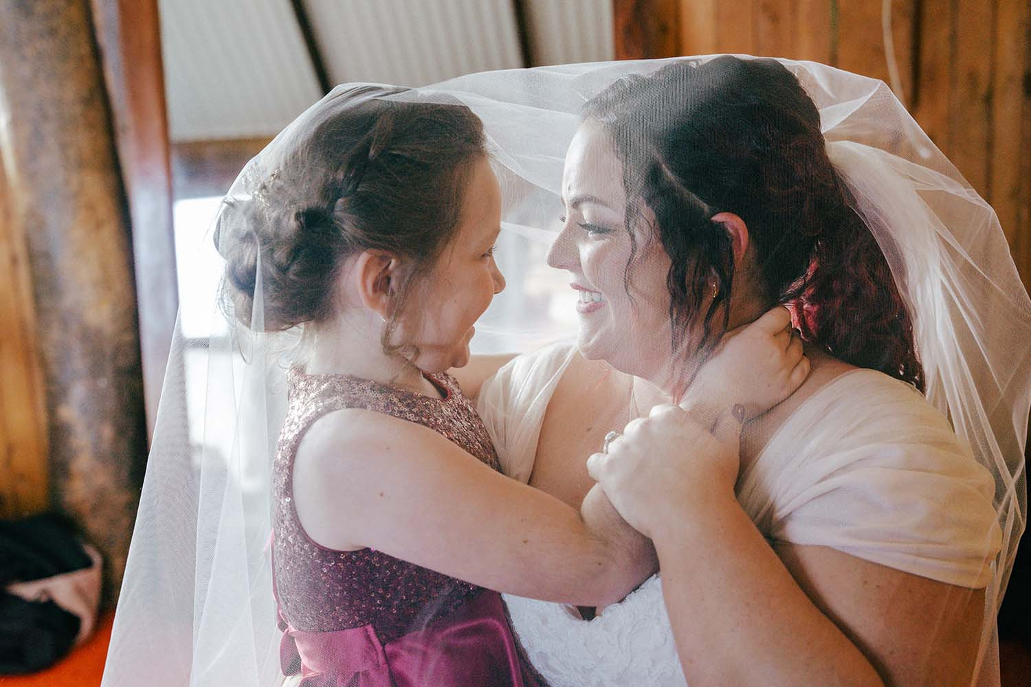 Wedding Photography - bride and daughter under veil