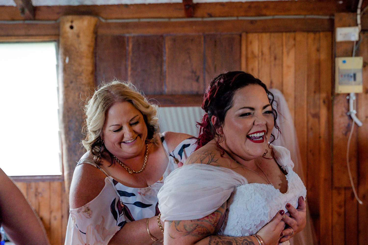 Wedding Photography - bride getting into dress