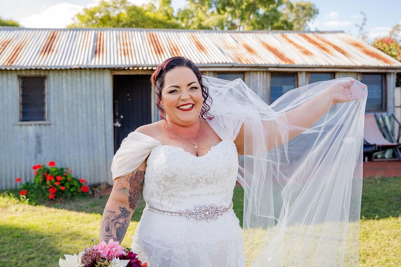 Wedding Photography - bride holding veil
