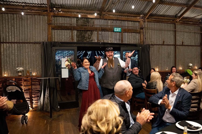 Wedding Photography - couple entering reception