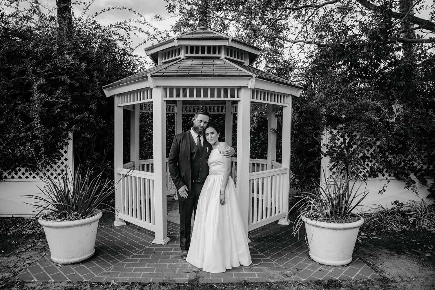 Wedding Photography - couple in front of pergola