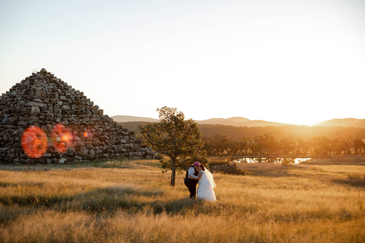 Wedding Photography - couple in front of rock pyramid