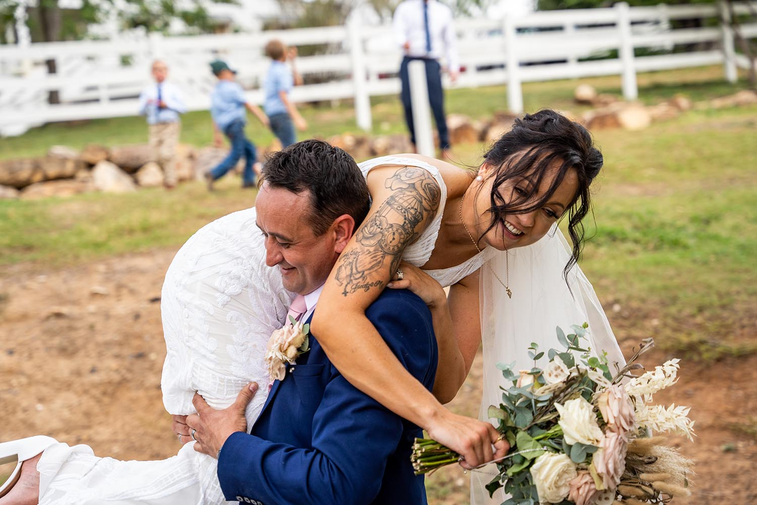 Wedding Photography - Carrying the bride