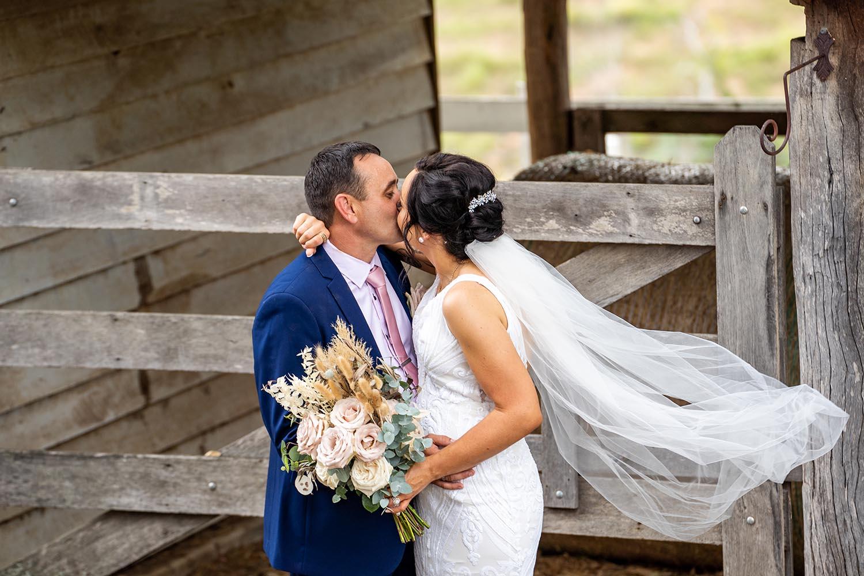 Wedding Photography - Rustic Farm kiss