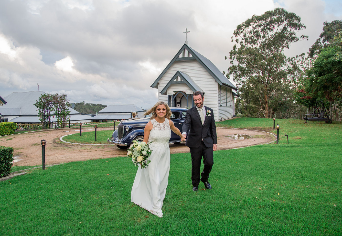 Wedding Photography couple at ceremony in front of church
