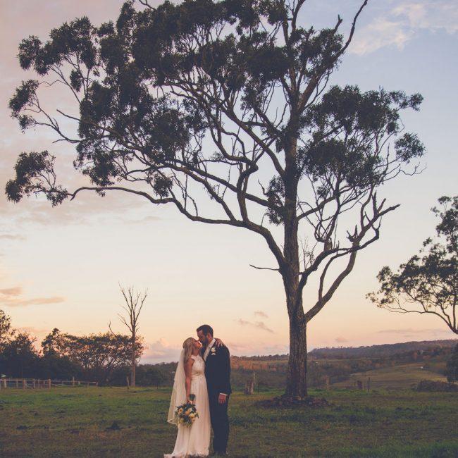 Wedding Photography couple kissing under tree