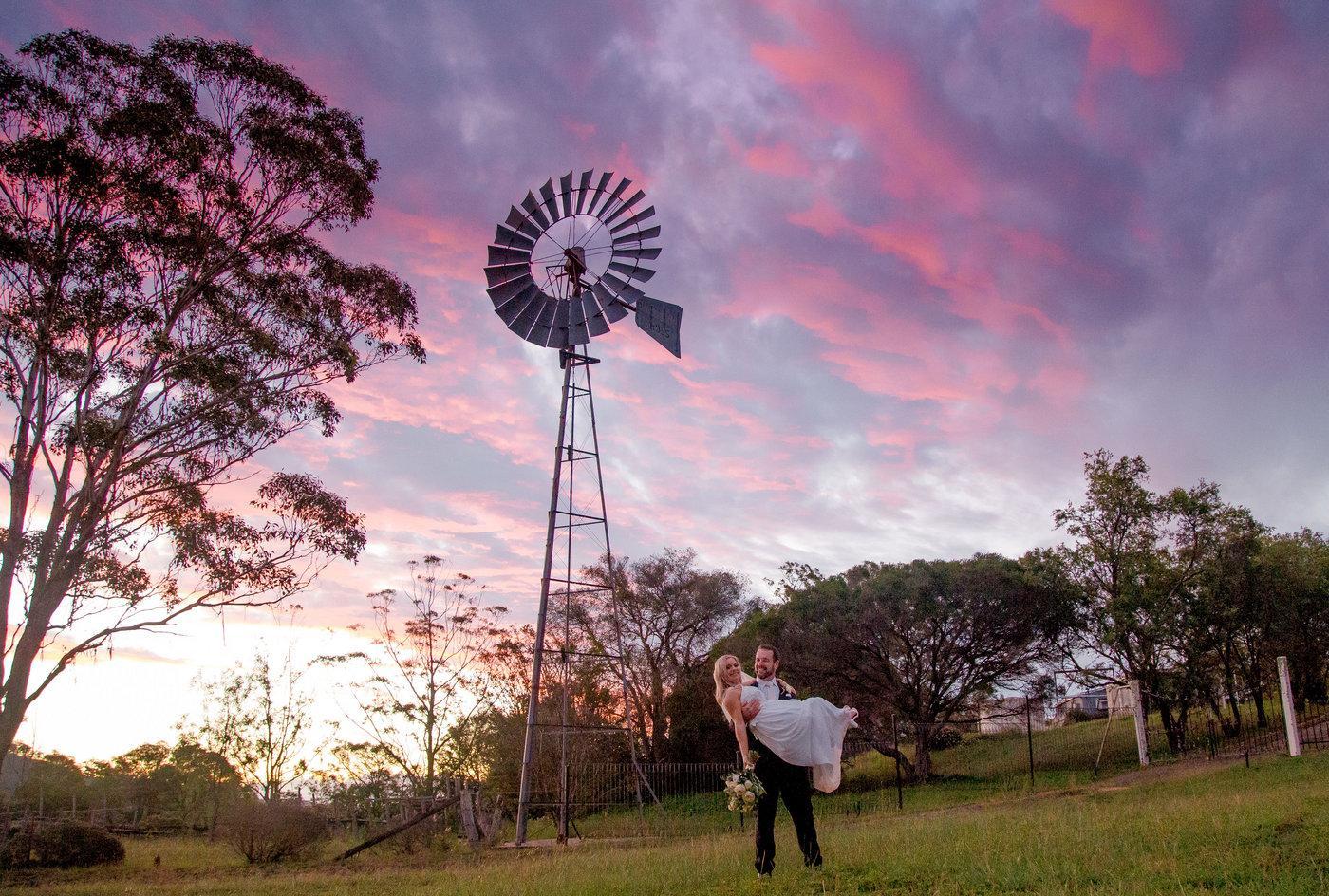 Ollie Santeesha wedding-couple under windmill at sunset