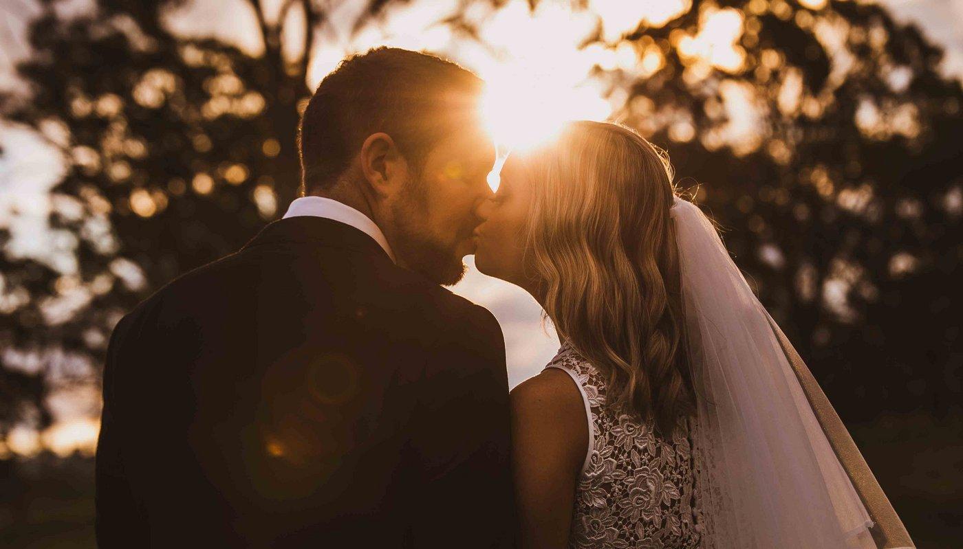 Wedding Photography kissing at sunset