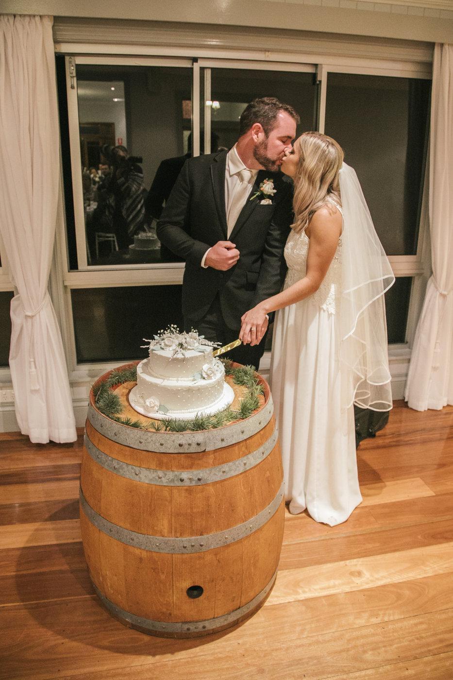 Wedding Photography reception cutting the cake