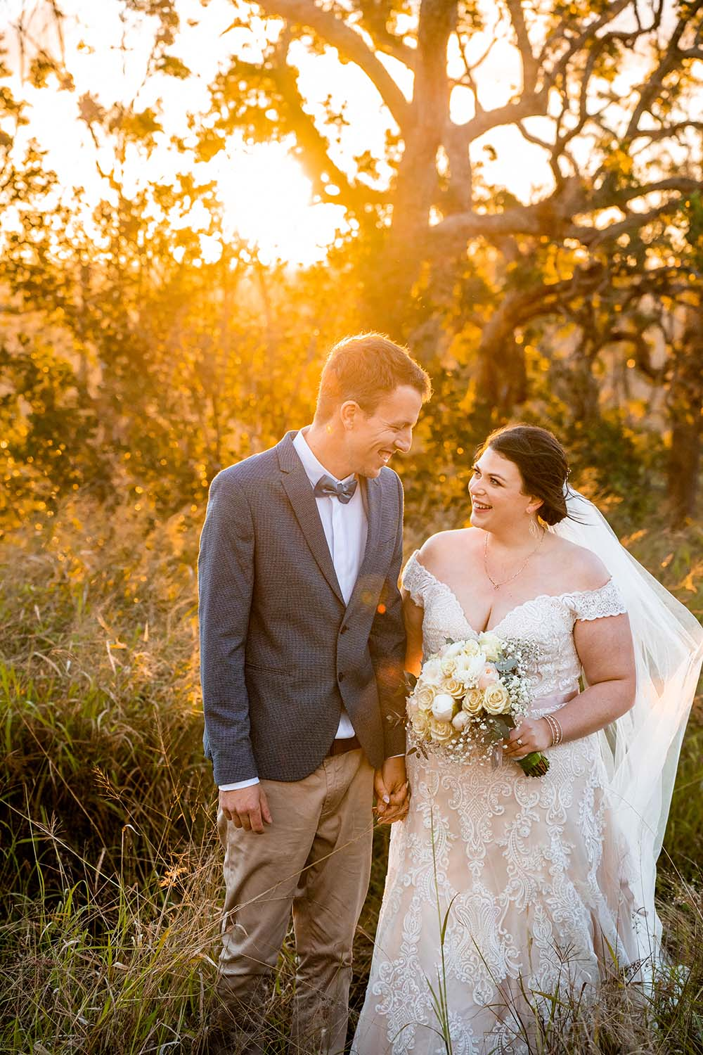 Wedding Photography - Bride and Groom in field at sunset