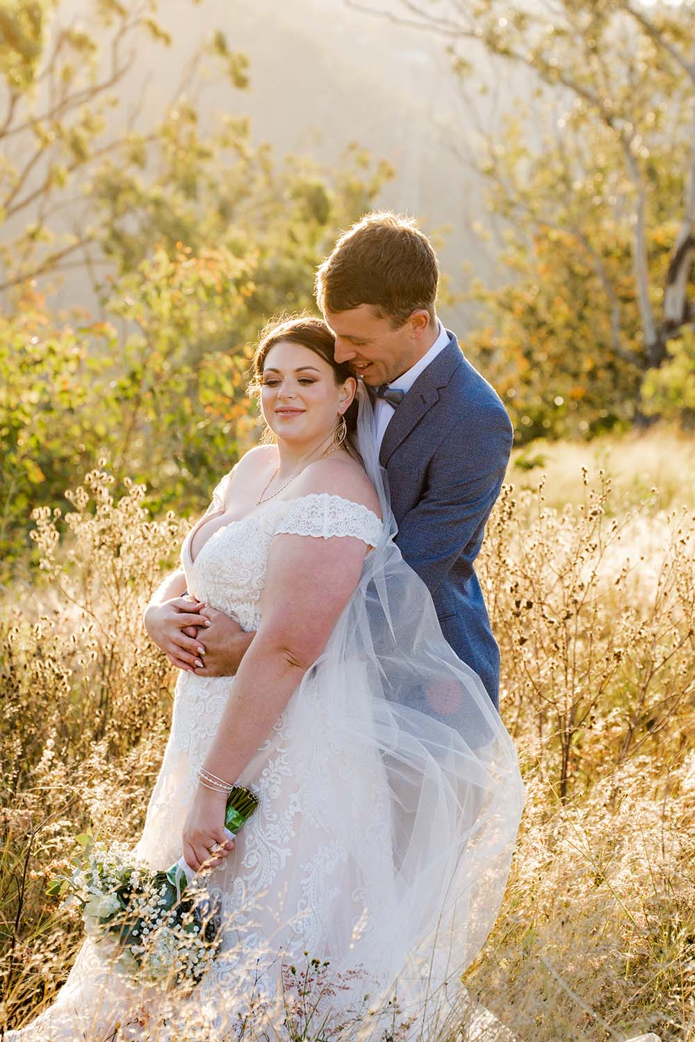 Wedding Photography - couple in field embracing