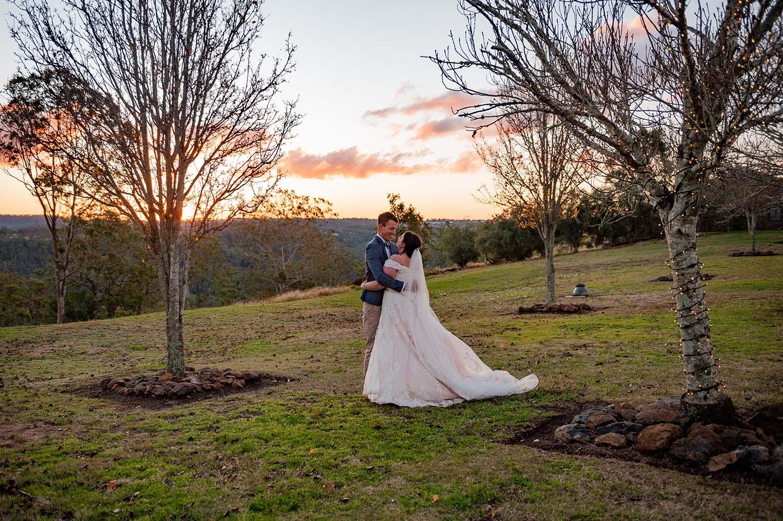 Wedding Photography - couple in field walking