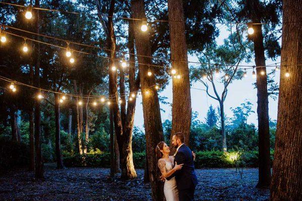 Wedding Photography - Bride and Groom embracing under lights