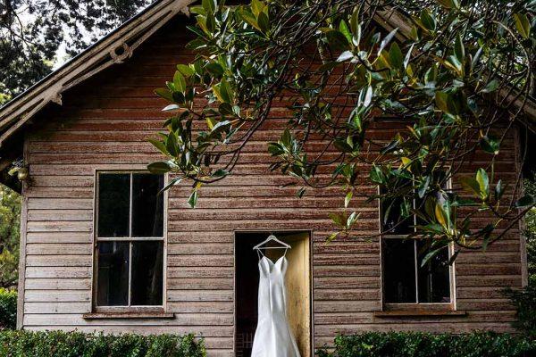 Wedding Photogrpahy - Dress hanging in doorway