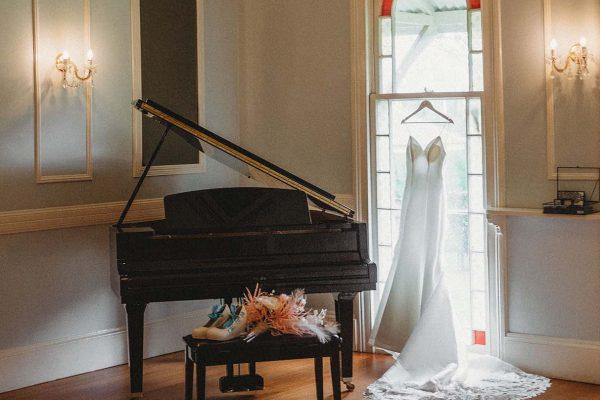 Wedding Photography - Dress hanging in window