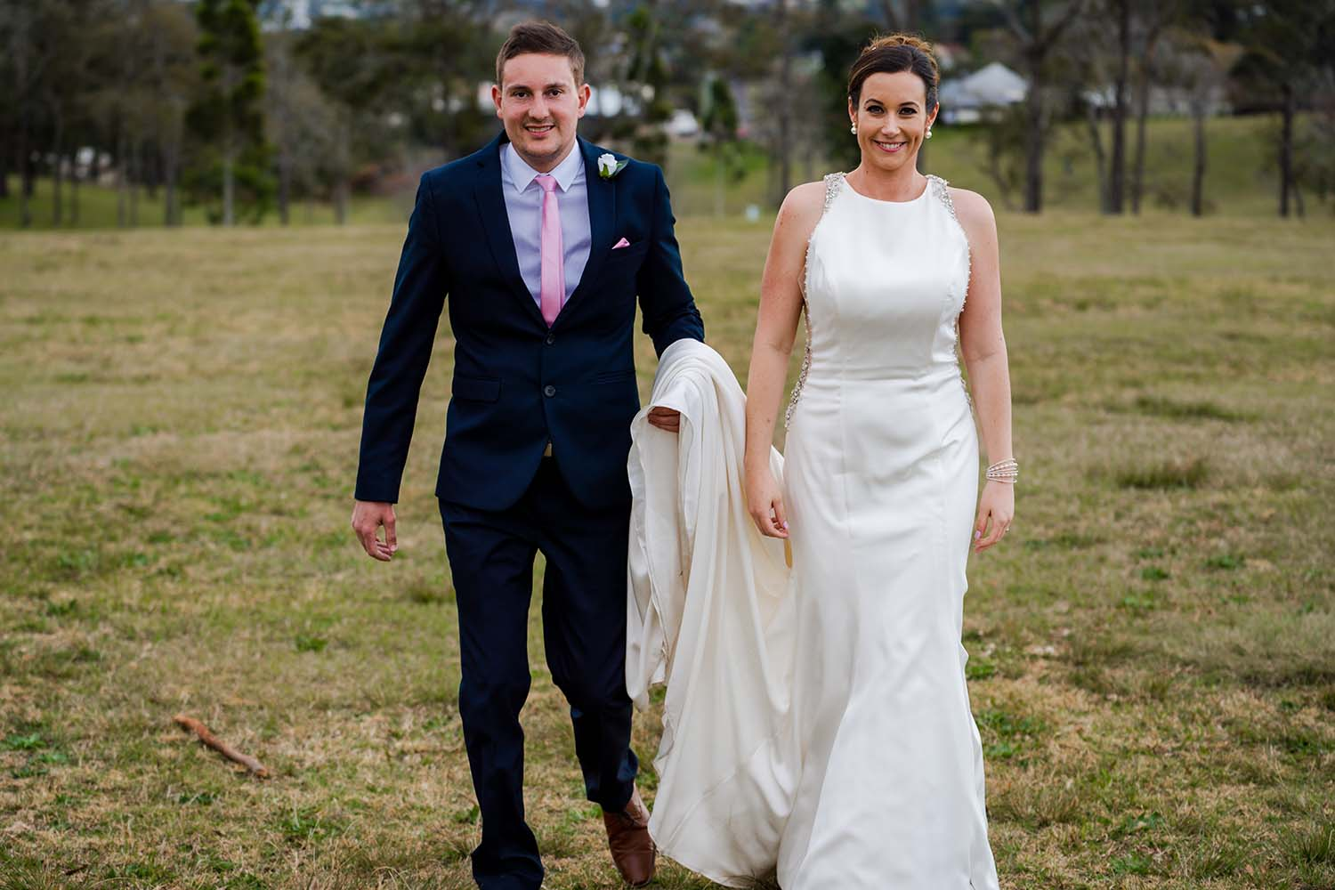 Wedding Photography - bride and groom in field