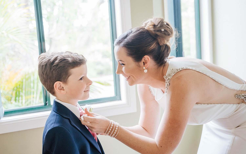 Wedding Photography - bride tying ring bearers ties