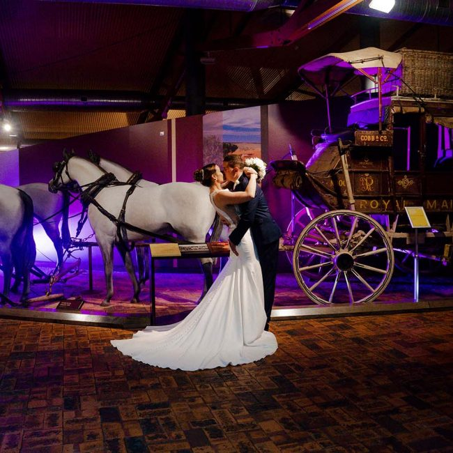 Wedding Photography - couple in front of museum exhibition