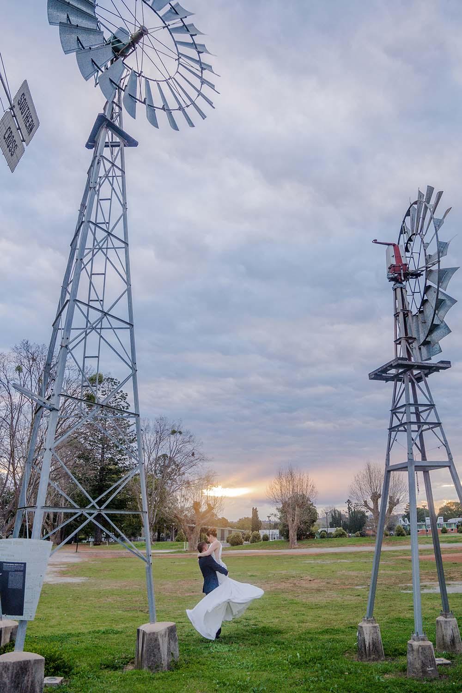Wedding Photography - couple under windmills