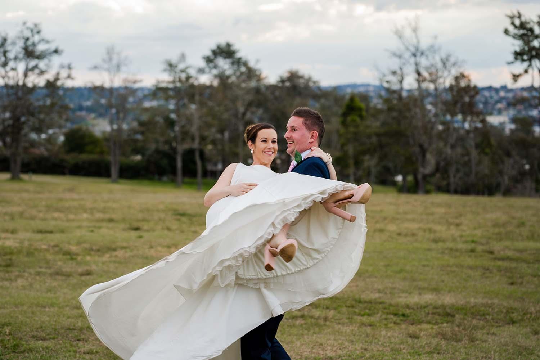 Wedding Photography - groom lifting bride