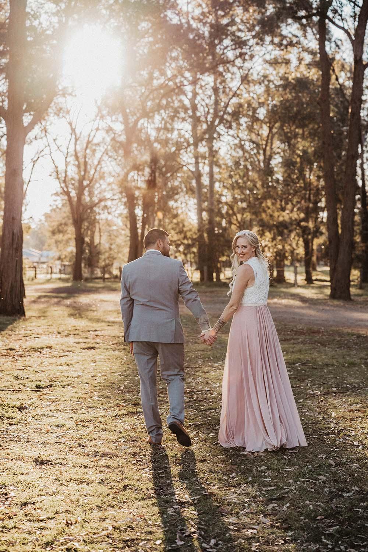 Wedding Photography - husband and wife walking