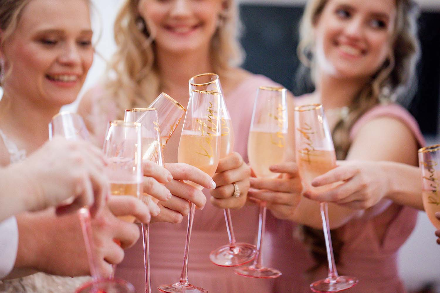 Wedding Photography - cheers with bridesmaids